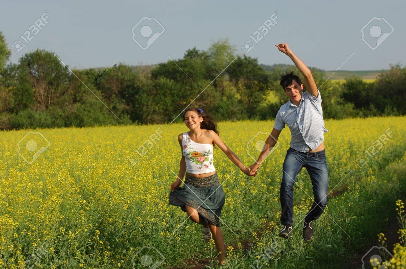 Love story. Running along the river, splashing Stock Photo - 14432259