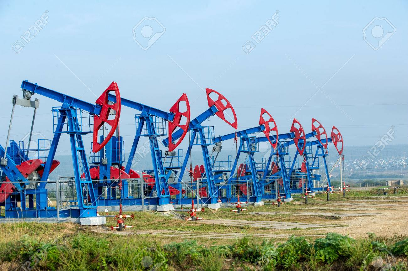 Work of oil pump jack on a oil field. Stock Photo - 31728153