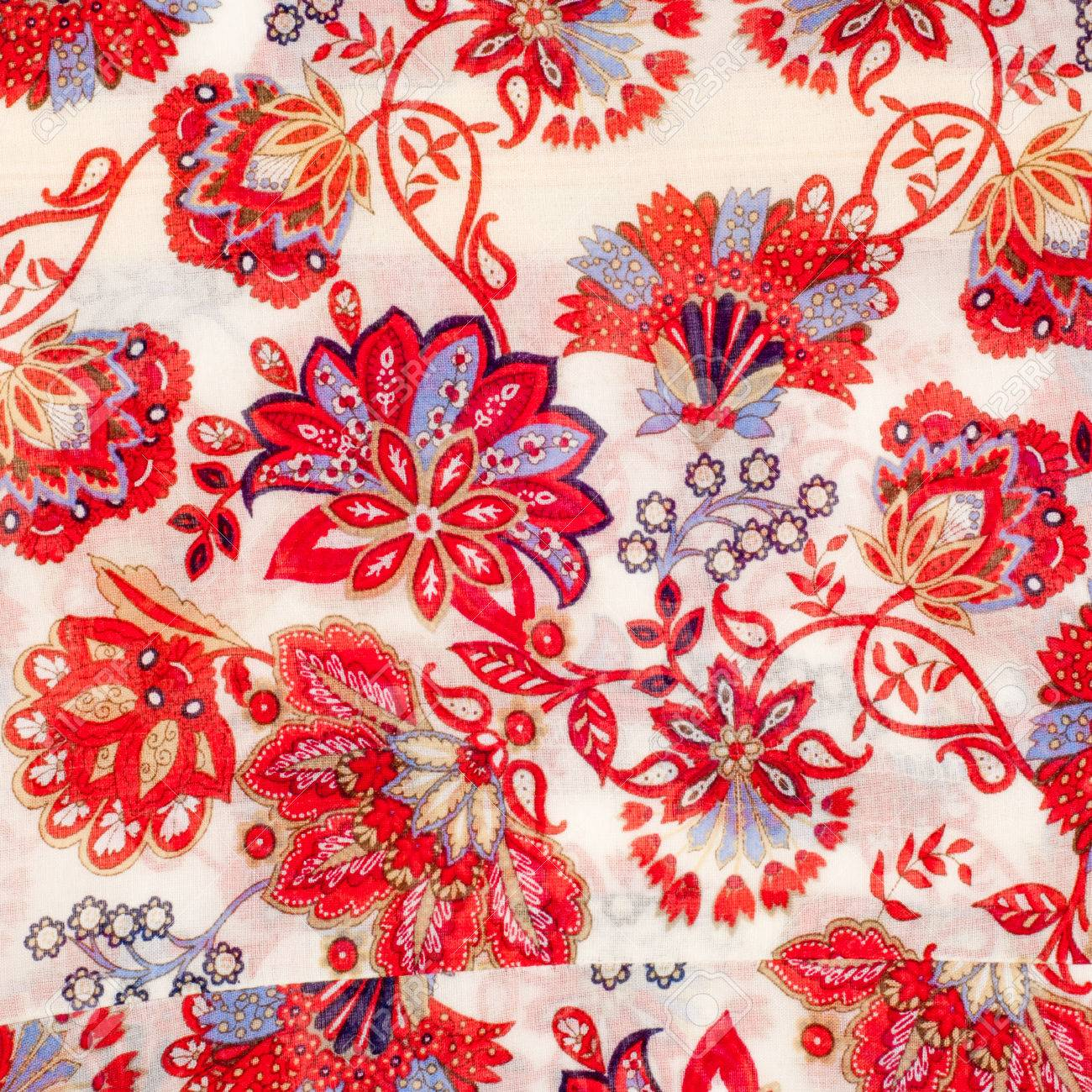 The Texture Of The Silk Fabric Red Flowers On A White Background