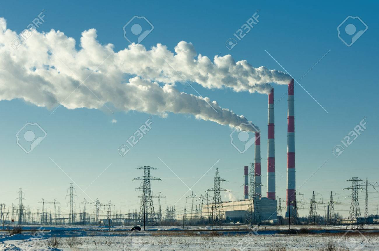 CHP. combined heat and power, a system in which steam produced in a power station as a byproduct of electricity generation is used to heat nearby buildings. Stock Photo - 43329191