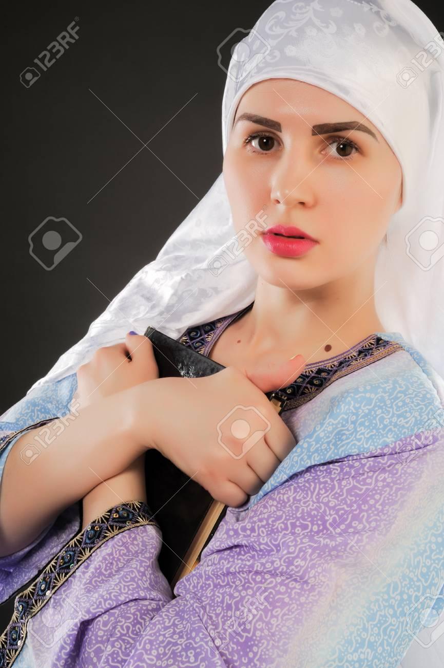 beautiful girl, a Muslim. wearing a hijab. Image of Muslim girl is holding