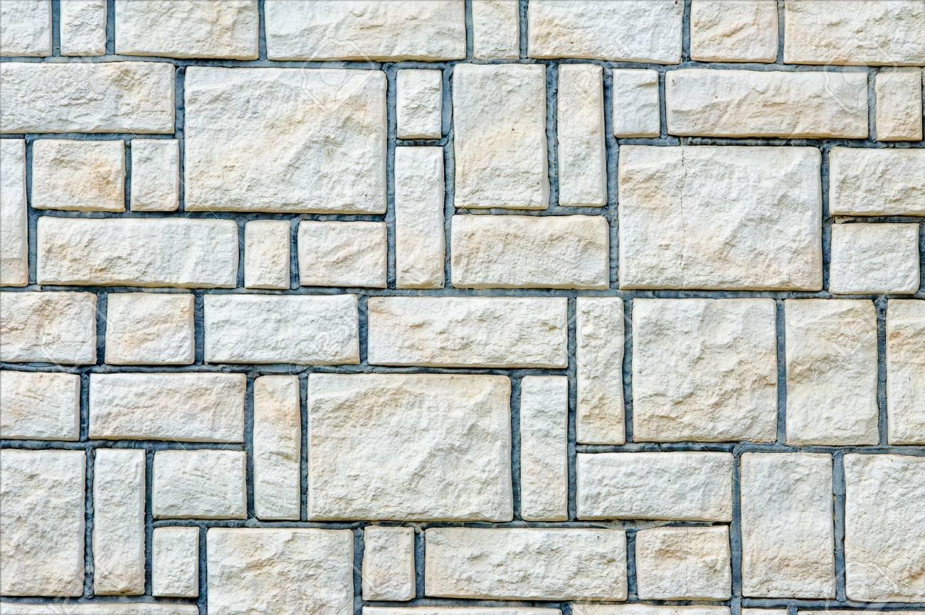 Muro Fatto In Pietra struttura, priorità bassa, schema. muri in pietra. sfondo di muro di pietra  fatto con blocchi