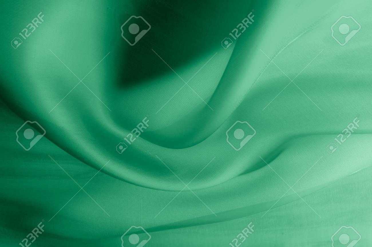 pretty nice 56ec4 a2bfd Struttura, priorità bassa, schema. Tessuto di seta verde pallido. È il  tulle molto morbido e sottile, il tulle morbido di seta. Sembra un drappo,  ...