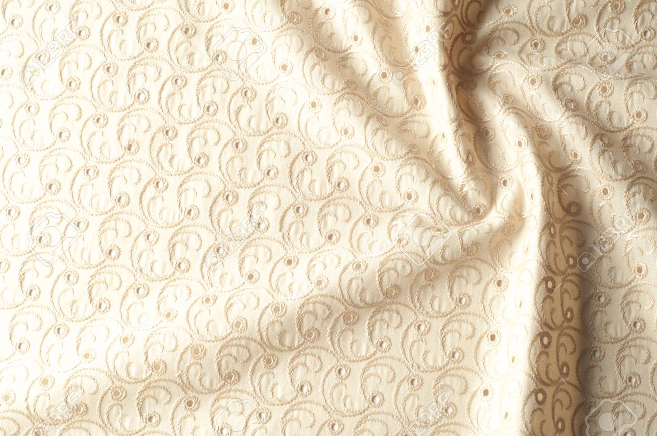 Texture background of fabric  Beige fabric with punctured circles