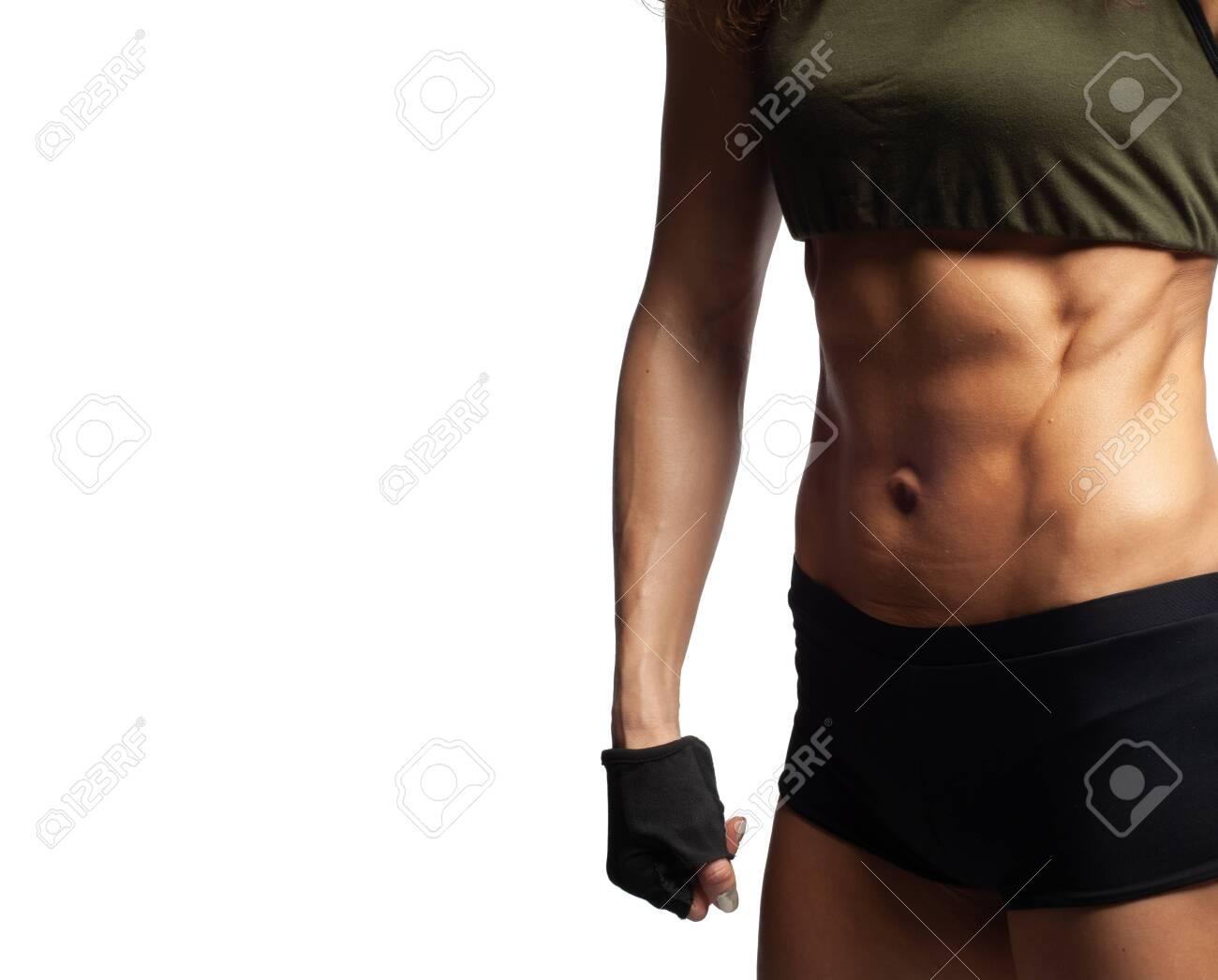 Studio photo of a model on a white background, Fitness healthy lifestyle, Beautiful tummy, embossed abdominal muscles, quickly pump up the abdominal press to a girl at home - 142456570