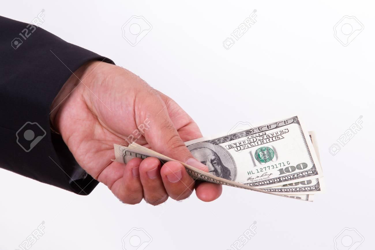 Achat D Homme D Affaires De Vendre Quelque Chose Et Donner De Dollars Qui Tient Isole Sur Fond Blanc Banque D Images Et Photos Libres De Droits Image 22623302