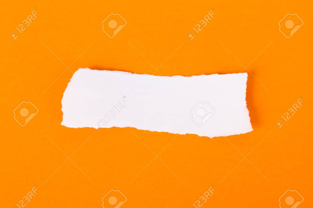 White torn piece of paper on orange background, ready for your message. Stock Photo - 22684648