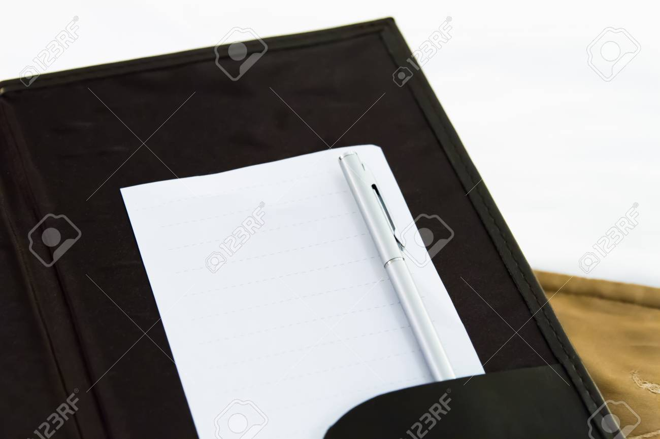 White blank note with pen on bed in hotel room. Stock Photo - 22721752