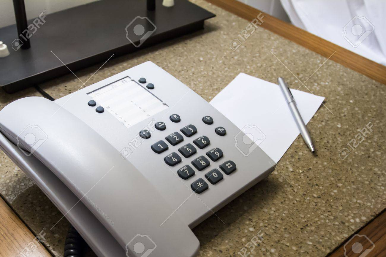 Telephone for customer service and blank white note paper with pen in hotel room. Stock Photo - 22723026