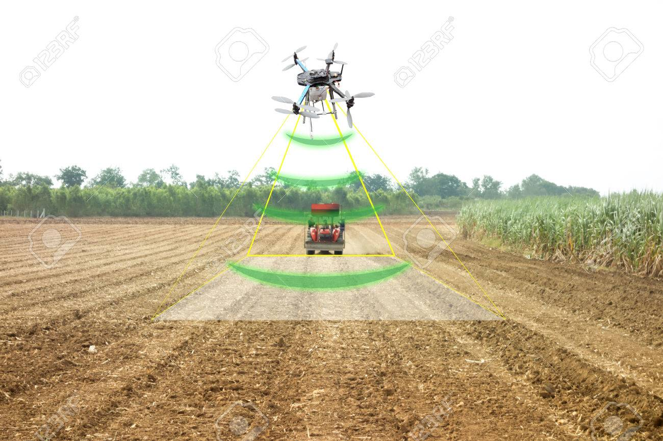 iot, internet of thins, agriculture concept, Farmer use drone to send a signal to detect and monitor the area while the tractor working in the farm with augmented reality technology - 83385105