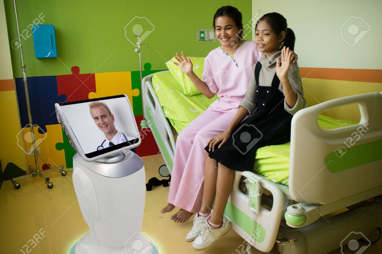doctor in hospital talk with the patient at patient room by telepresence robotic and it caretakers can interact with their patient check on their living conditions and the need for further appointments - 86628843