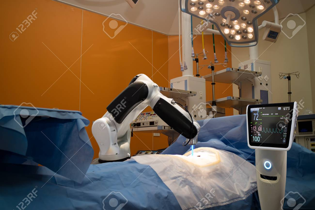 advanced robotic surgery machine at Hospital,some of major advantages of robotic surgery are precision, miniaturisation, smaller incisions, decreased blood loss, less pain, and quicker healing time - 86877710