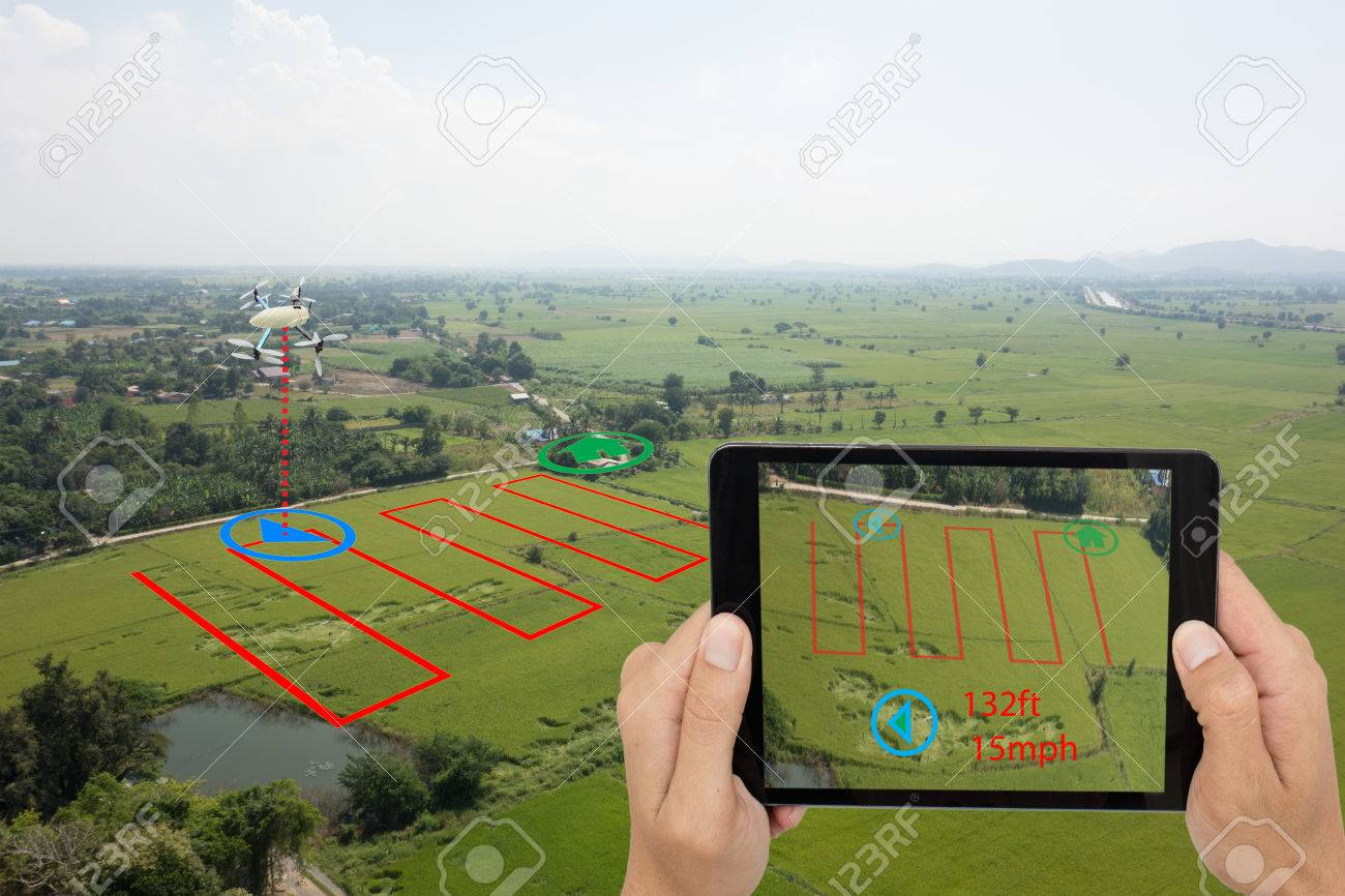 smart farming concept, drone use a technology in agriculture with artificial intelligence to measure the area, photographer, and fly follow the line and send the data back to farmer in cloud system - 87476542
