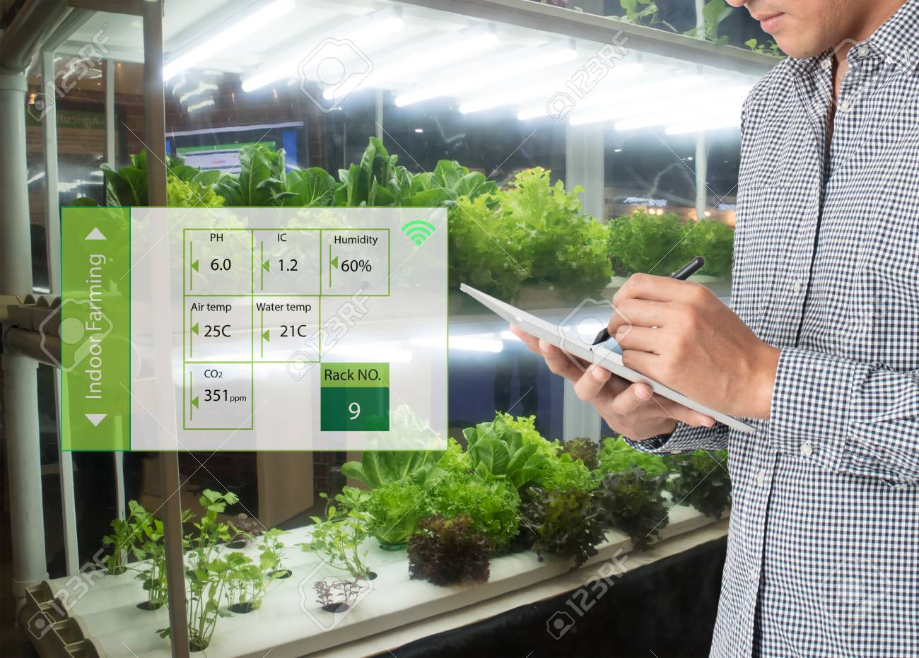 smart agriculture in futuristic concept, farmer use technology to monitor, control and adjustment led, atmosphere,humidity, water level and keep tracking harvesting time in vertical or indoor farming - 87117741