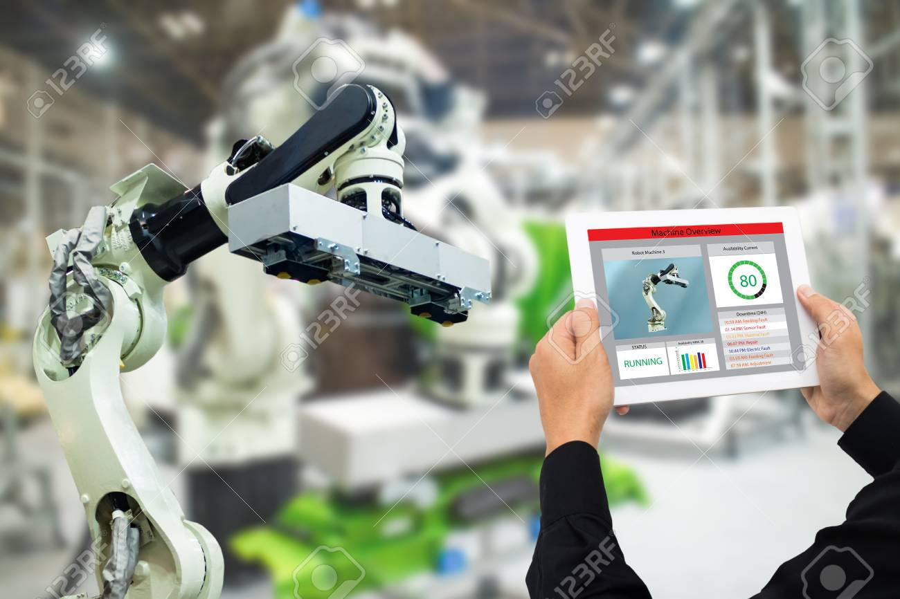 iot industry 4.0 concept,industrial engineer using software (augmented, virtual reality) in tablet to monitoring machine in real time.Smart factory use Automation robot arm in automotive manufacturing - 93748370