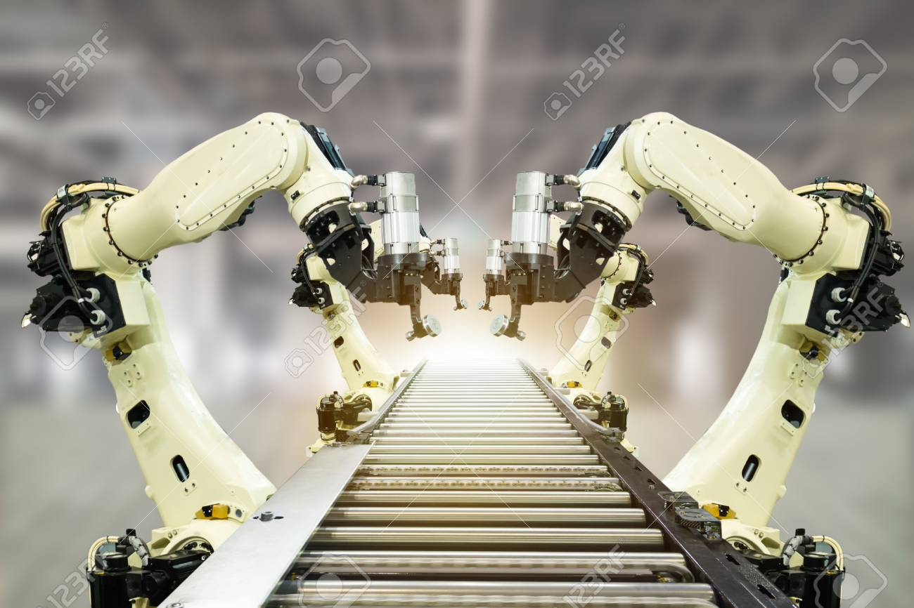 iot industry 4.0 technology concept.Smart factory using trending automation robotic arms with part on conveyor belt in operation line. Automotive manufacturing use it for precision, Repetition, intense - 93721434