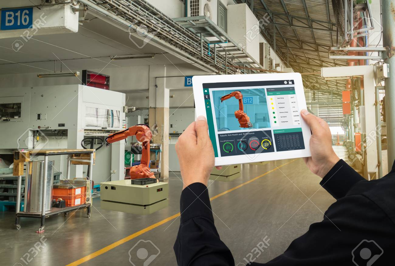 iot industry 4.0 concept,industrial engineer using software (augmented, virtual reality) in tablet to monitoring machine in real time.Smart factory use Automation robot arm in automotive manufacturing - 93708159