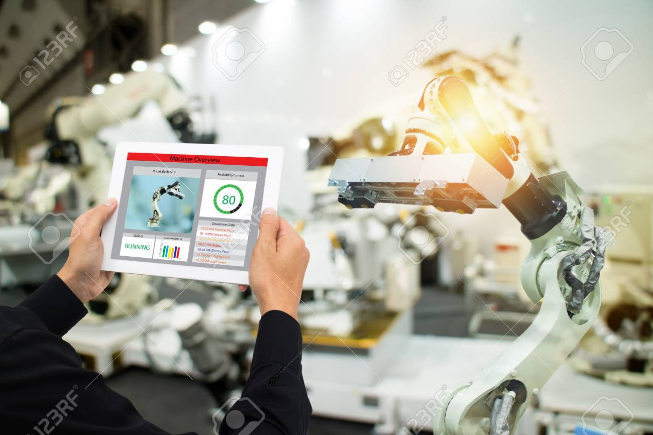 iot industry 4.0 concept,industrial engineer using software (augmented, virtual reality) in tablet to monitoring machine in real time.Smart factory use Automation robot arm in automotive manufacturing - 94306454