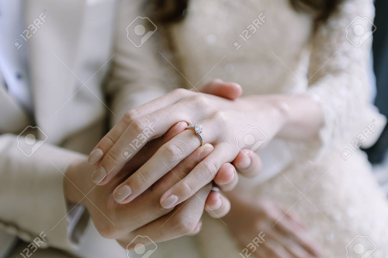 Hand Of Lover Are Wearing A Ring On Her Wedding Day Stock Photo