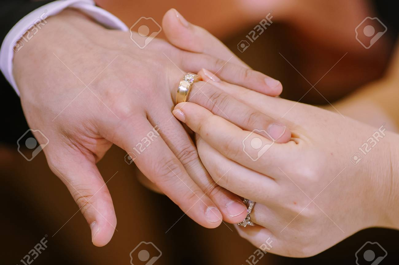 Hand Of Lover Are Wearing A Ring On Her Wedding Day Stock Photo ...
