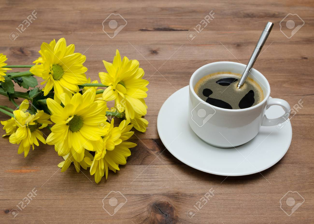 Cup Of Coffee With Yellow Flowers On Old Wooden Table Stock Photo