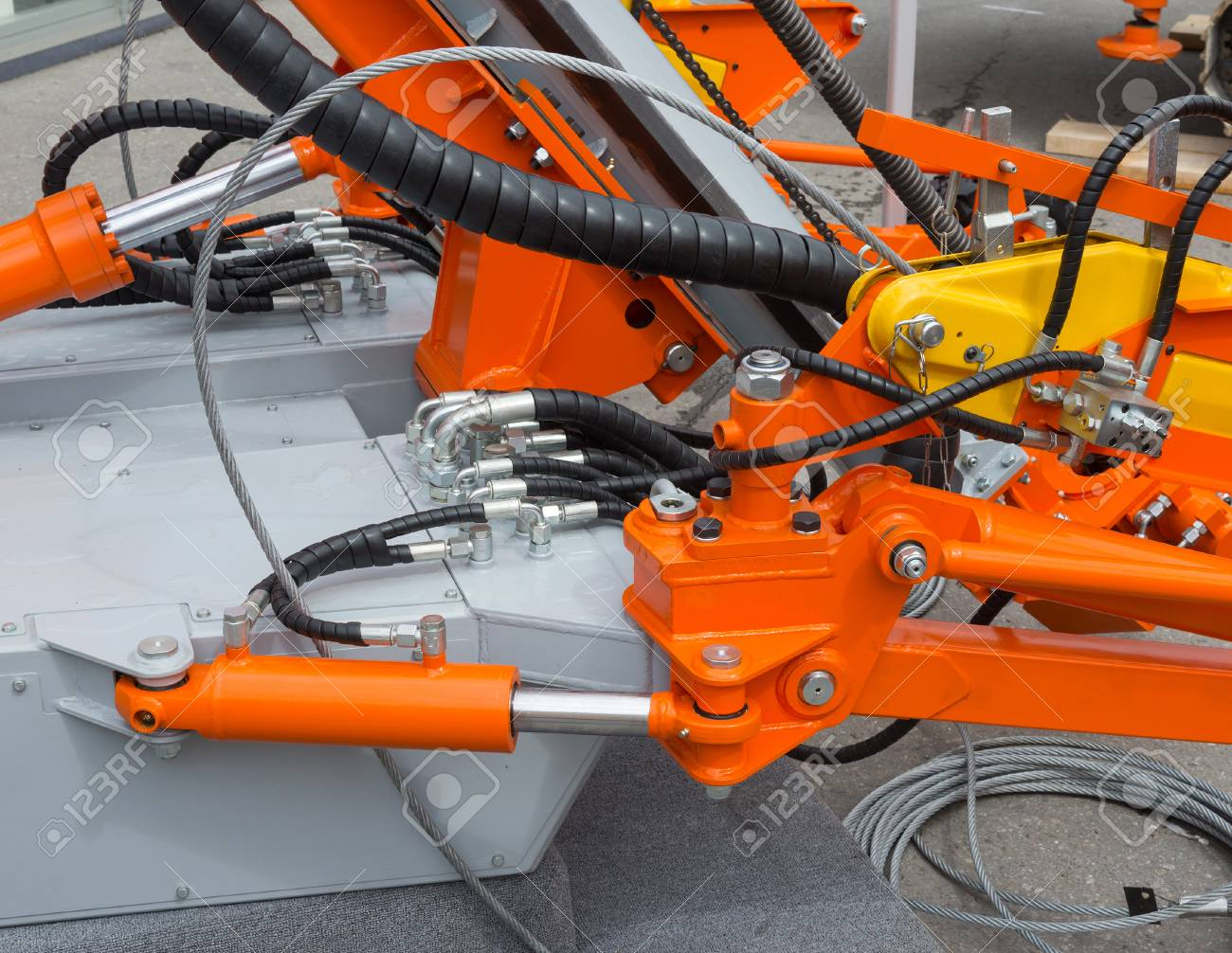 Hydraulic tubes, fittings and levers on control panel of lifting mechanism - 106433029