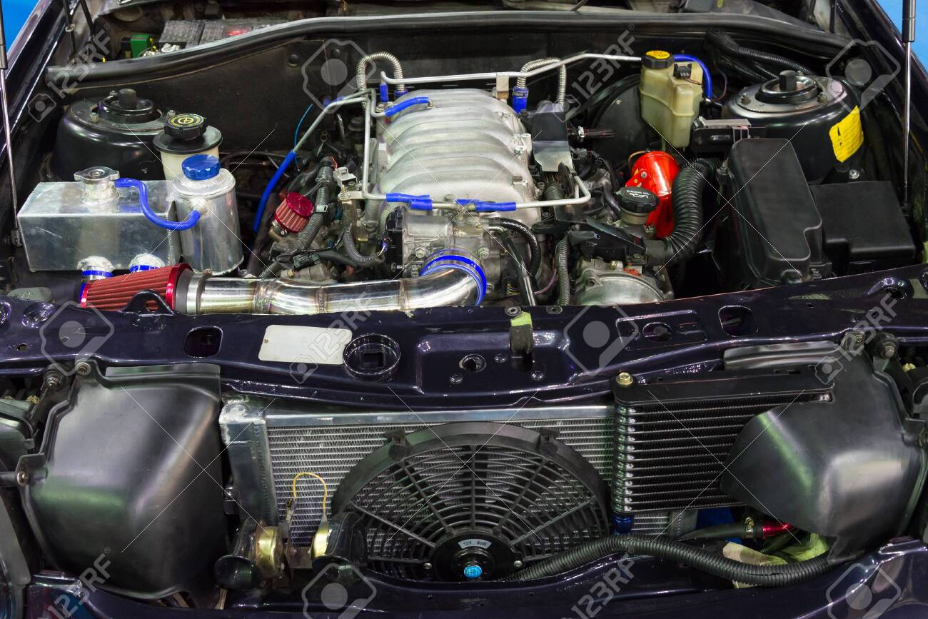 Closeup of the old powerful car engine. Internal design of engine. - 131729696