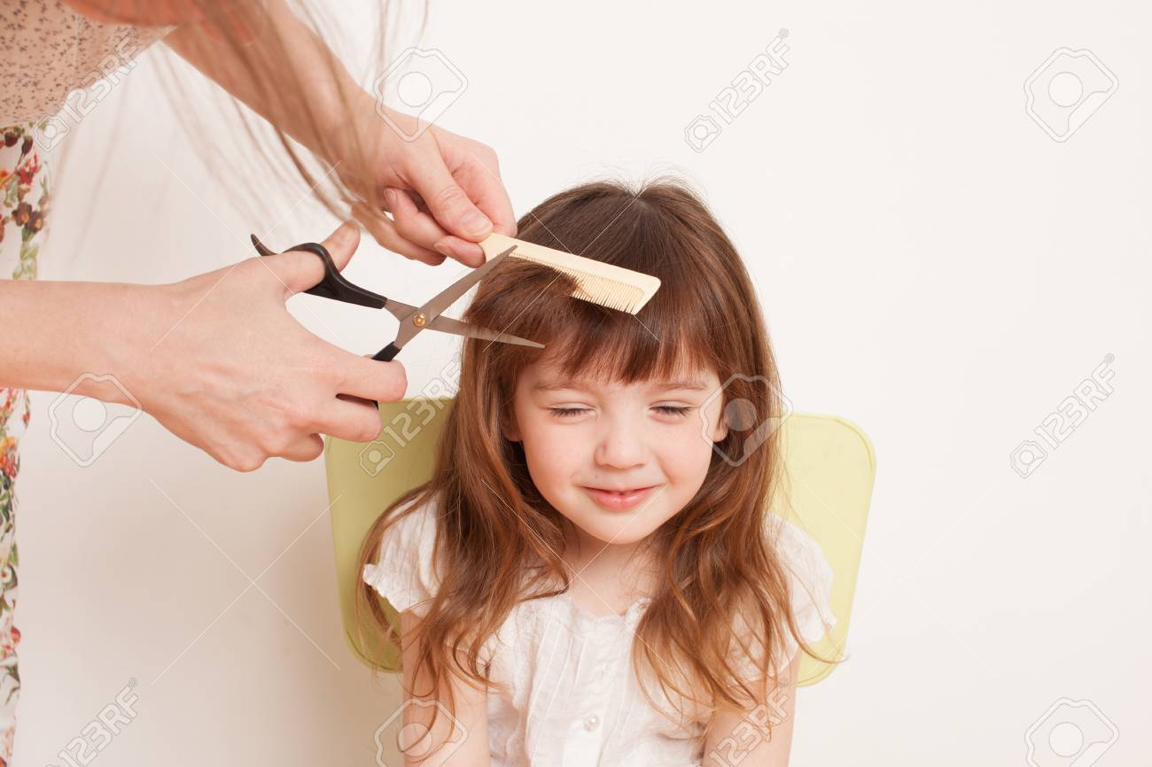 Woman Cuts The Baby Hair The Girl Is Afraid To Cut Hair He Stock