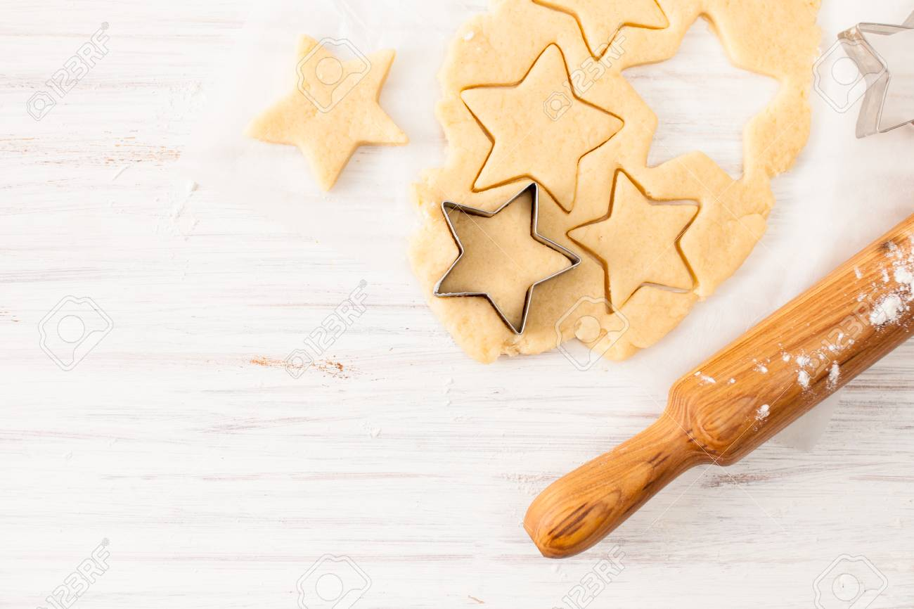 The preparation of the biscuits. The dough for making Christmas cookies. The background image of the process of cookie making. - 90857936
