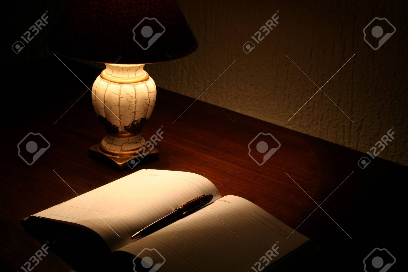 Planner and lamp on desktop Stock Photo - 8052662