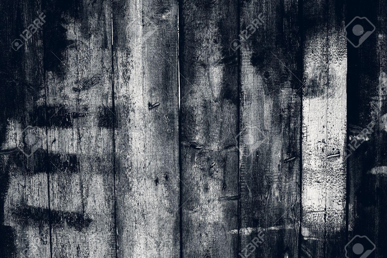 Background gloomy charred wooden fence in dark