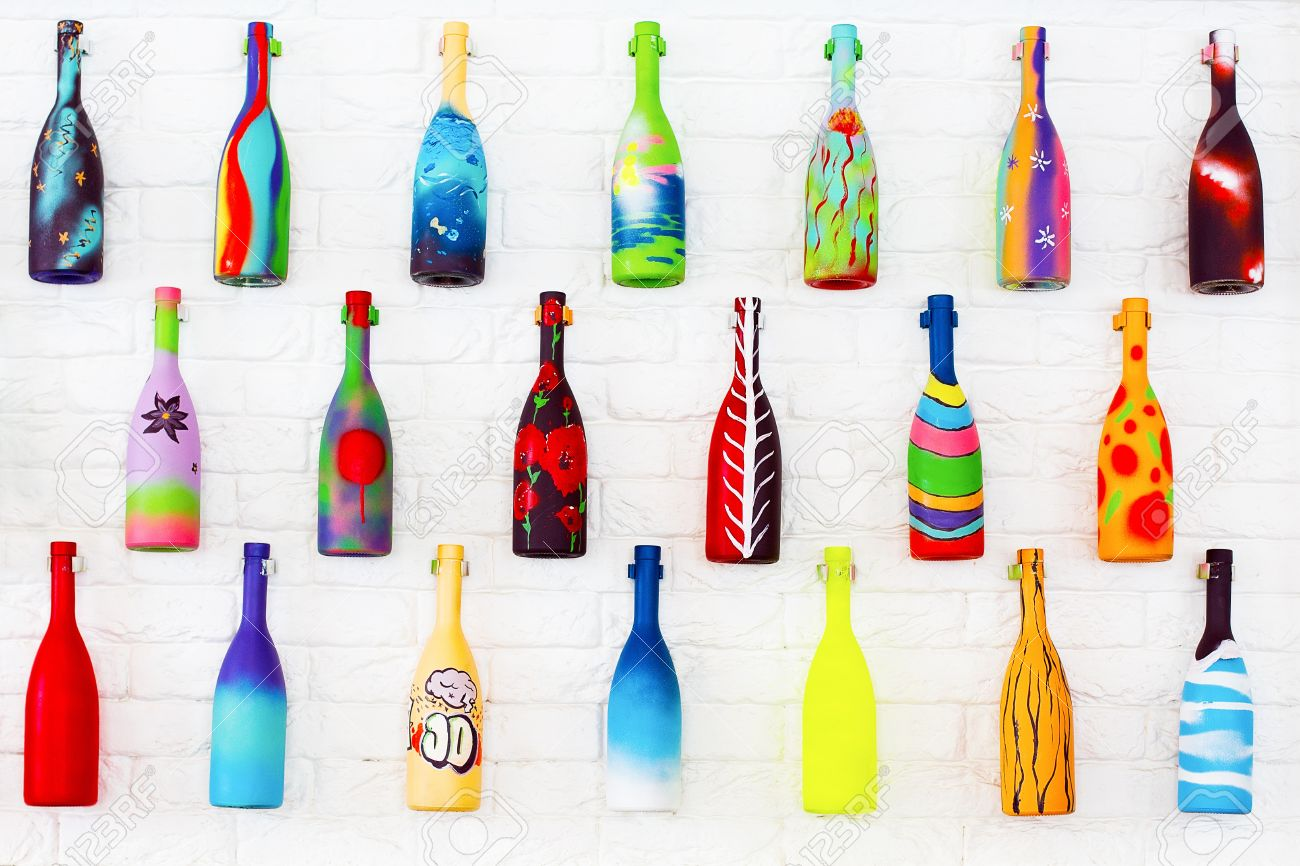 Bright Decorative Bottles Hanging On A White Brick Wall Stock Photo Picture And Royalty Free Image Image 20445822