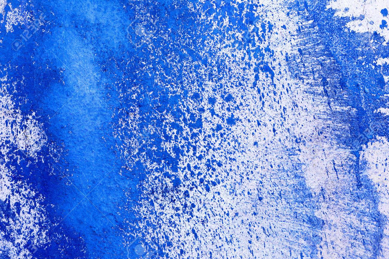 creative beautiful blue background blue spray paint on concrete with cracks and scratches landscape