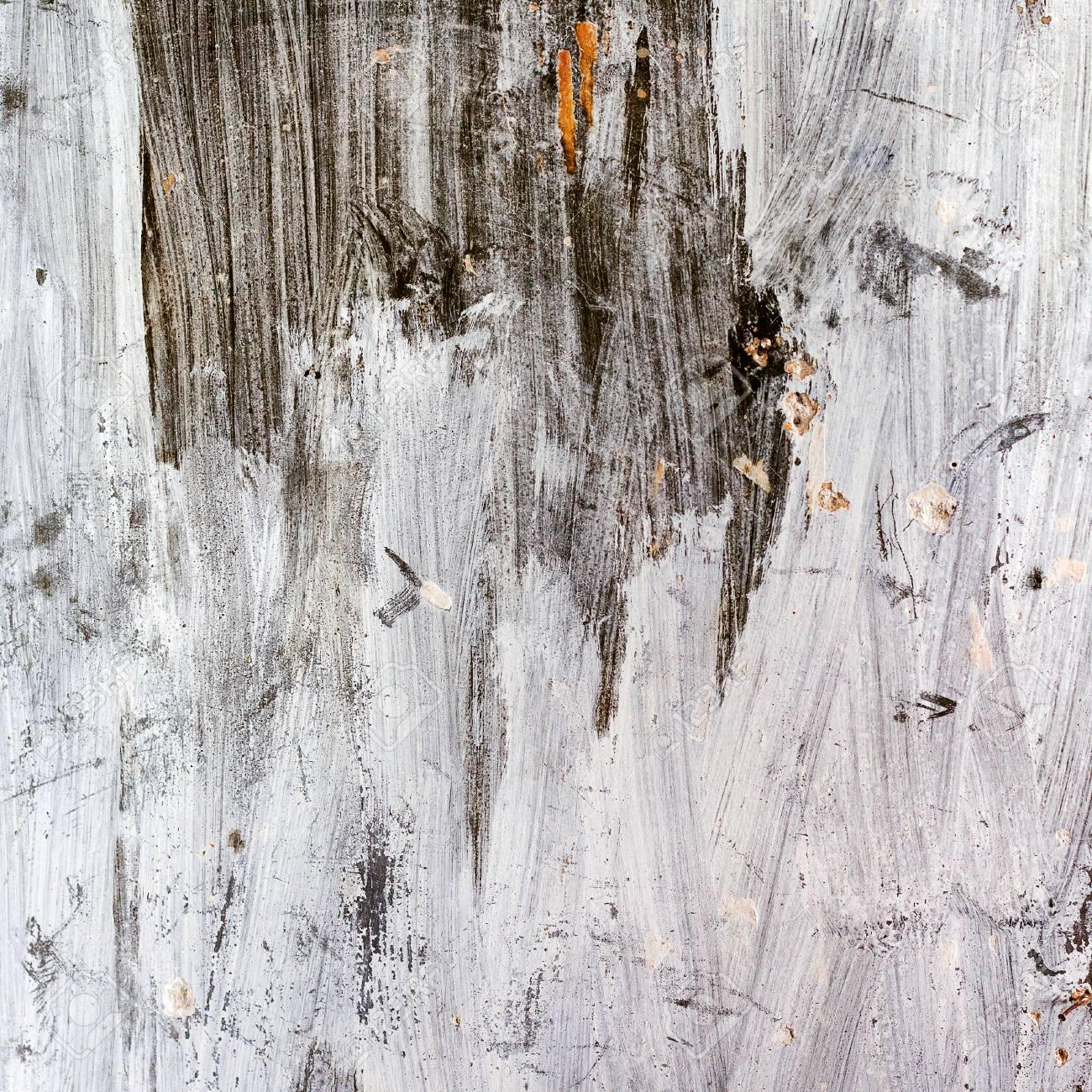 Fond Abstrait Mur De Béton Sombre Avec Désinvolture Peint Peinture Vert Foncé A Mûri Avec Des Fissures Et Des Rayures Dans Le Mur Martelé Un Clou