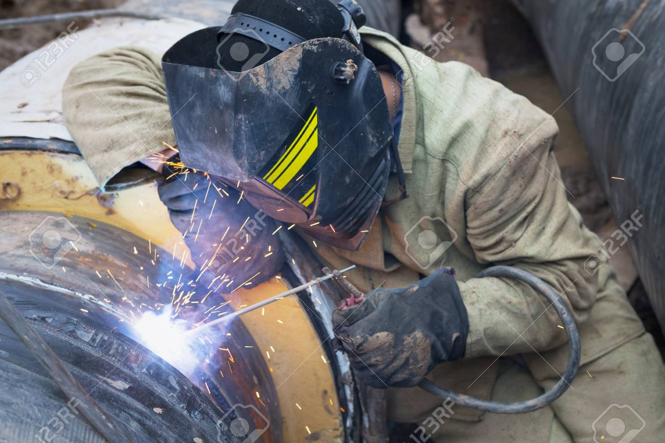 Repair of heating duct  The workers, welders made by electric