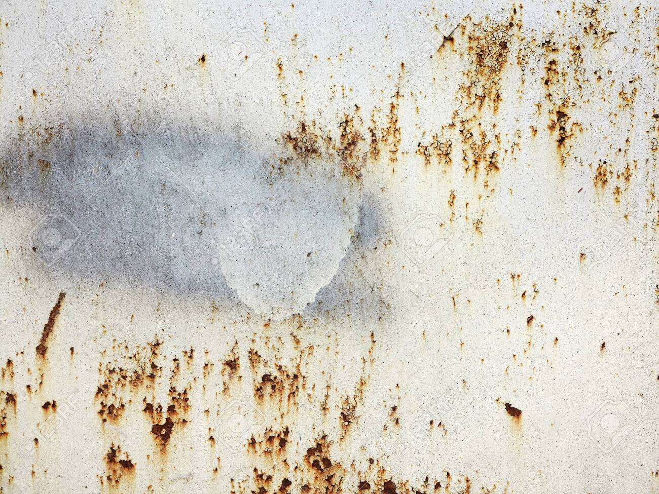 Bright multi-colored paint on rusty metal surface. Rusty metal wall, old sheet of iron covered with rust with multi-colored paint. As textured authentic background for your project - 120759553