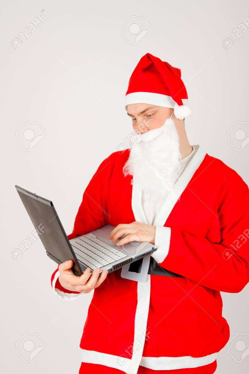 Santa Claus with a laptop Stock Photo - 8261801