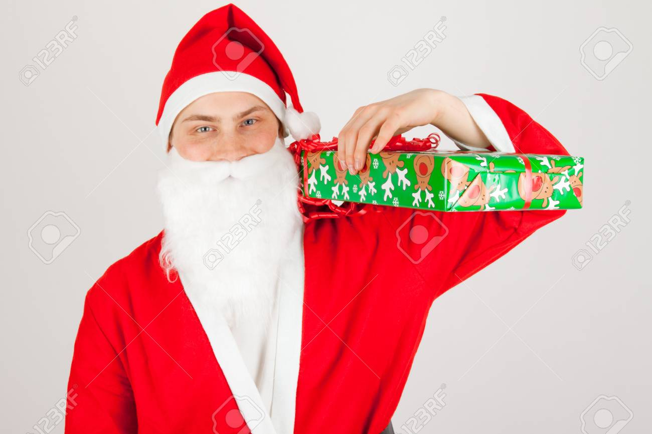 Santa Claus loaded with Christmas gifts Stock Photo - 8261805