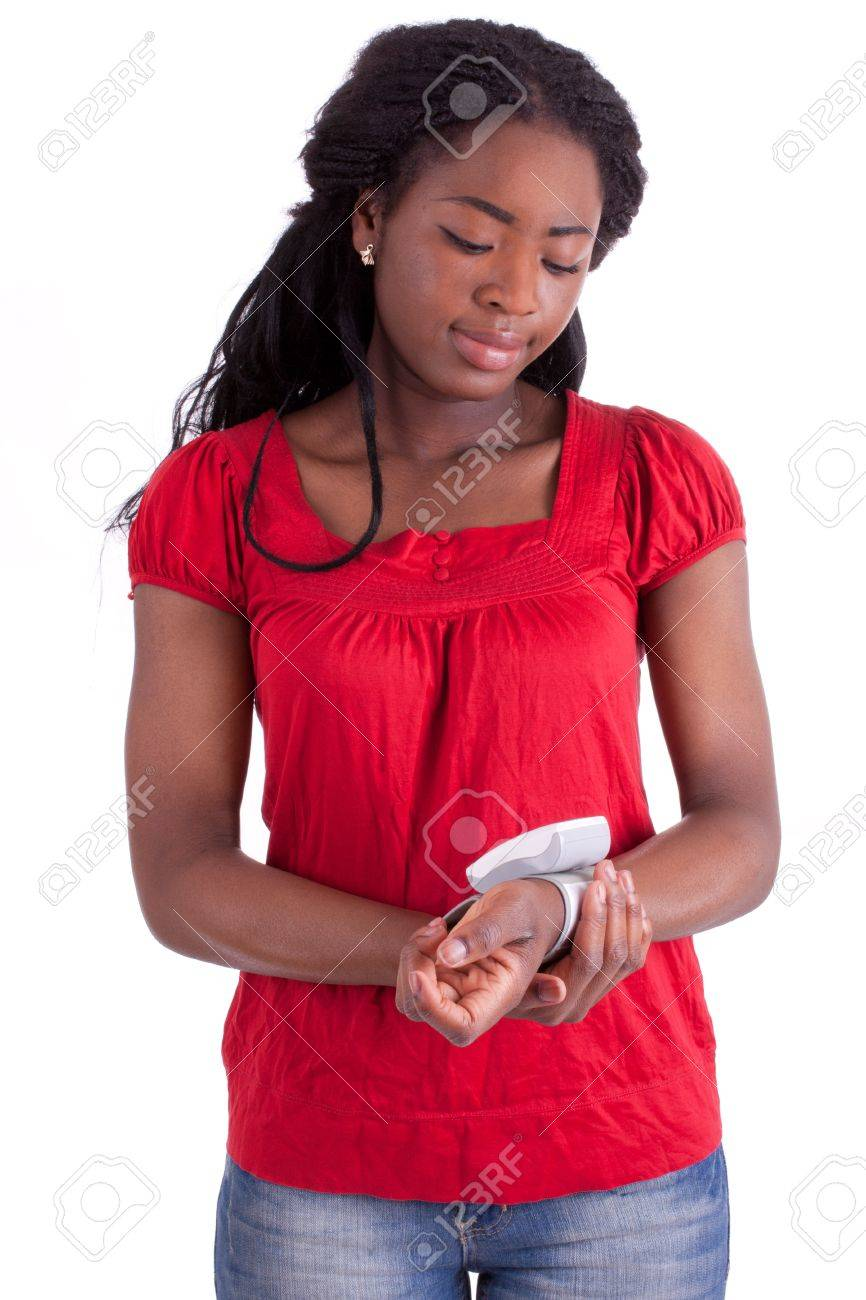 A young black woman is measuring her blood pressure Stock Photo - 9409052