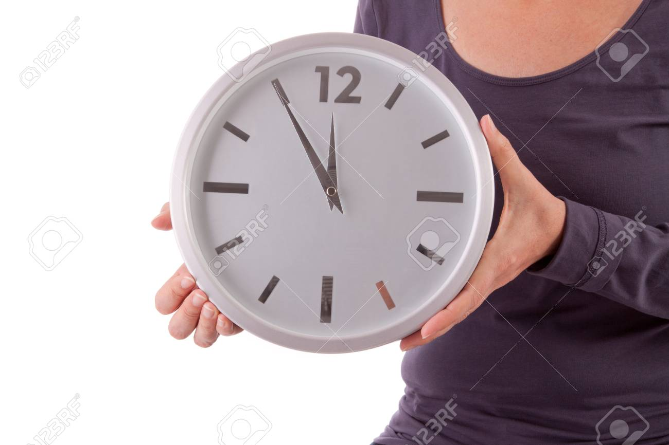 A young woman is holding a clock in her hands Stock Photo - 11012382