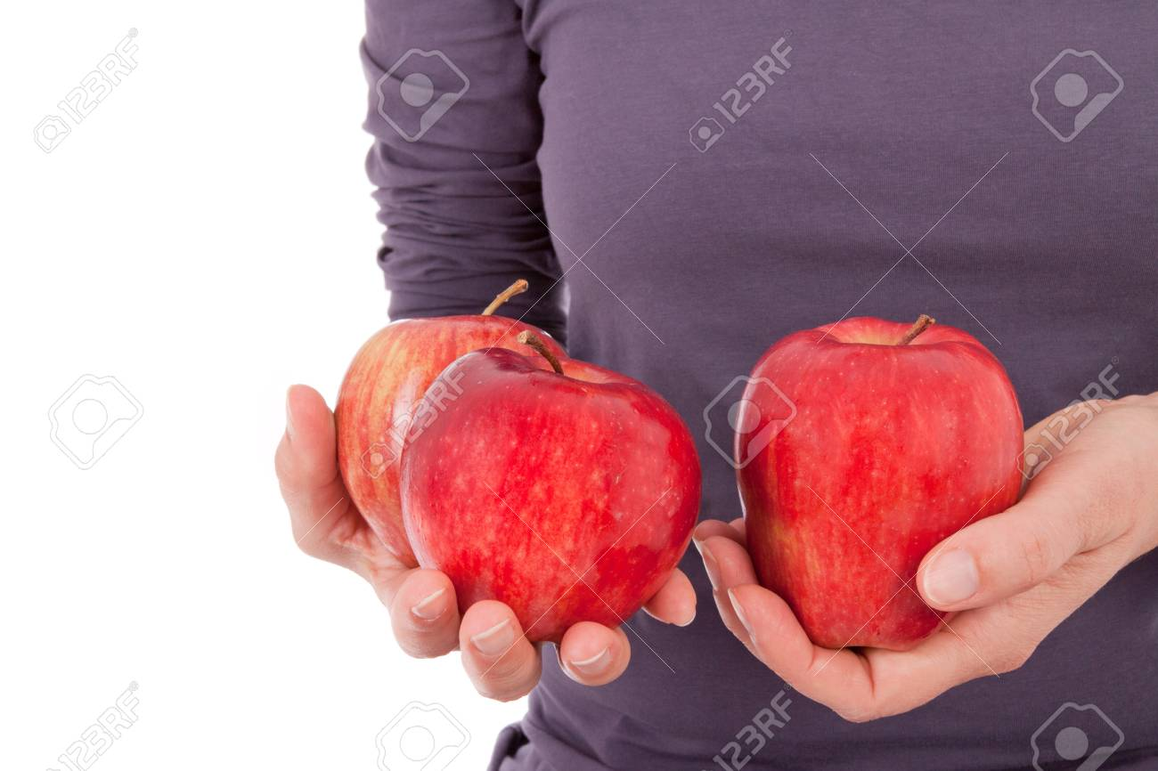 A young woman is holding apples in her hand Stock Photo - 11012390