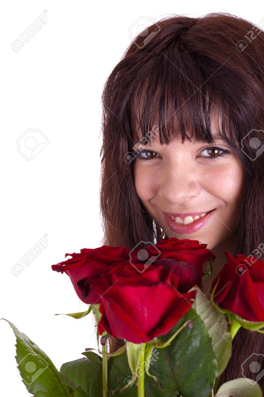 A young beautiful girl is holding a bunch of roses in her hand Stock Photo - 12474616