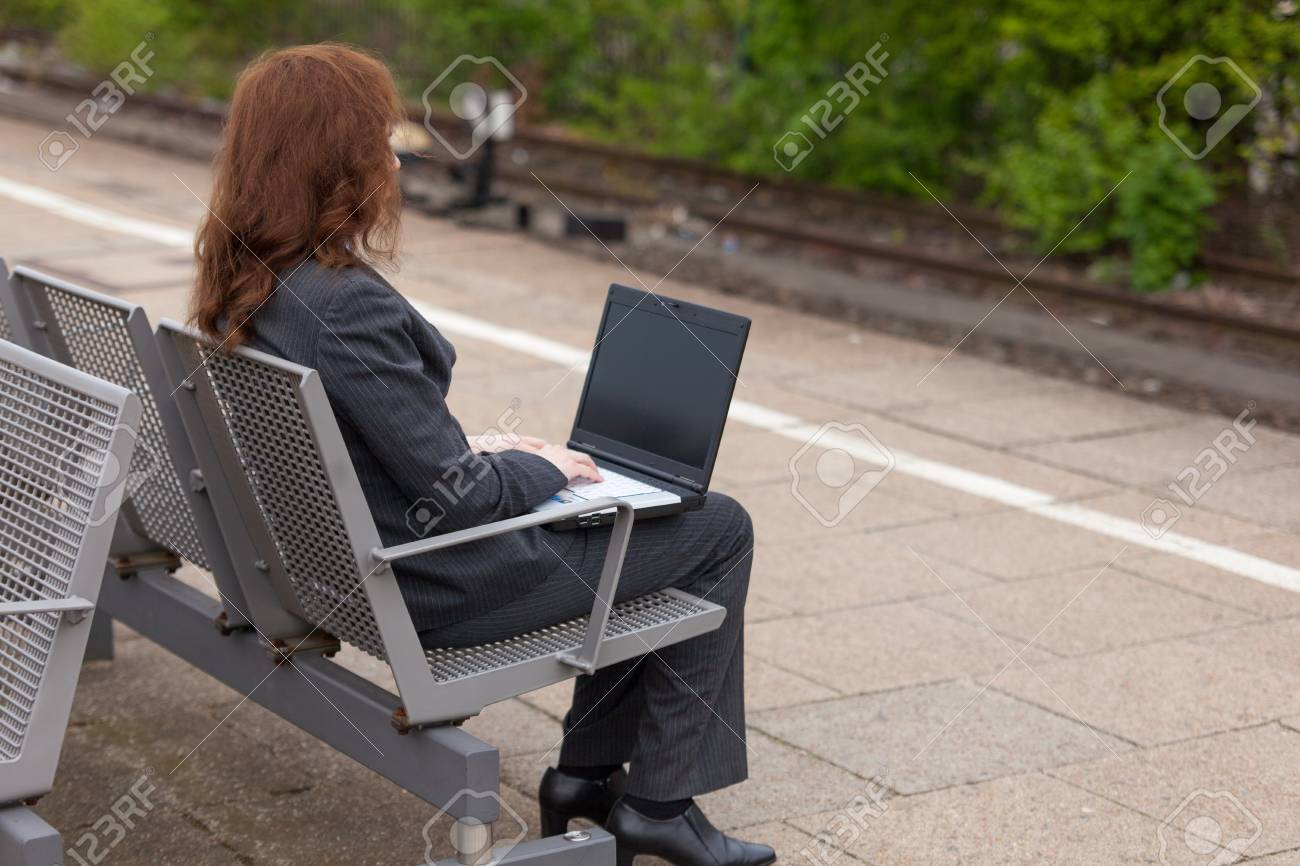 A young business woman is waiting for her train Stock Photo - 13484915