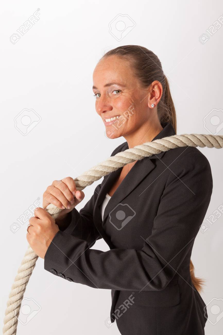 A young woman is pulling at a thick rope Stock Photo - 18343738