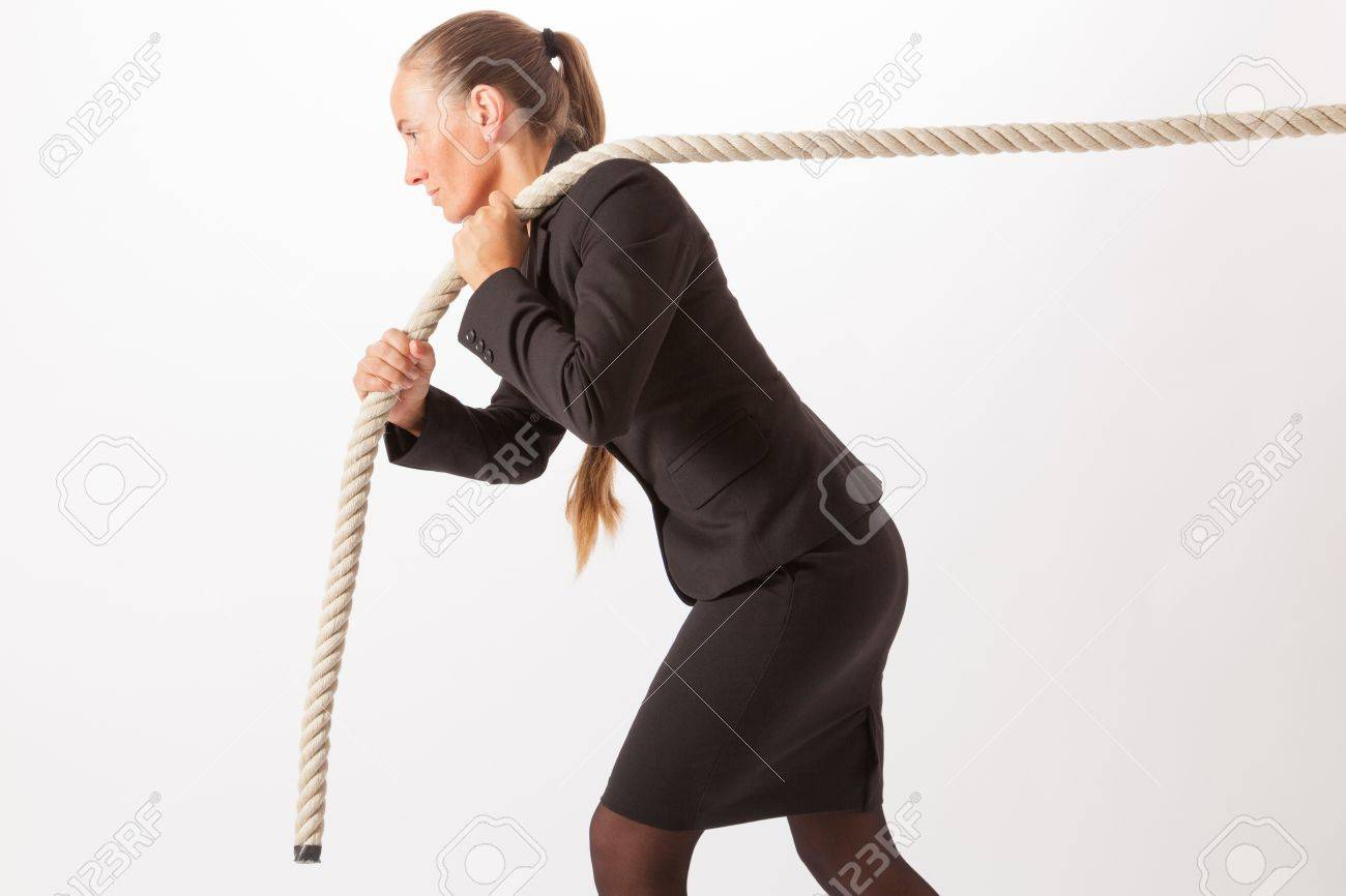 A young woman is pulling at a thick rope Stock Photo - 18343651