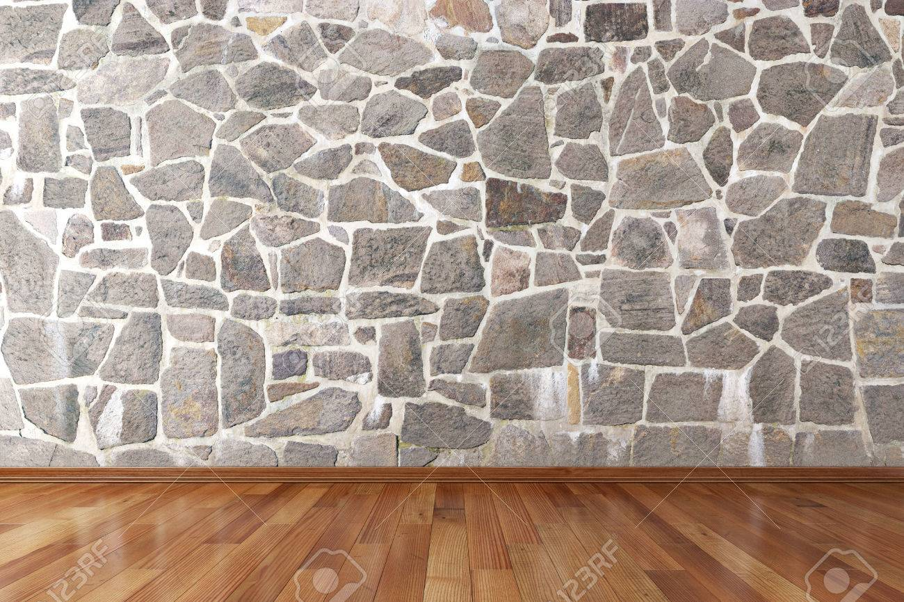 Floor tiles stock photos royalty free business images empty room with stone wall and wooden floor stock photo dailygadgetfo Gallery