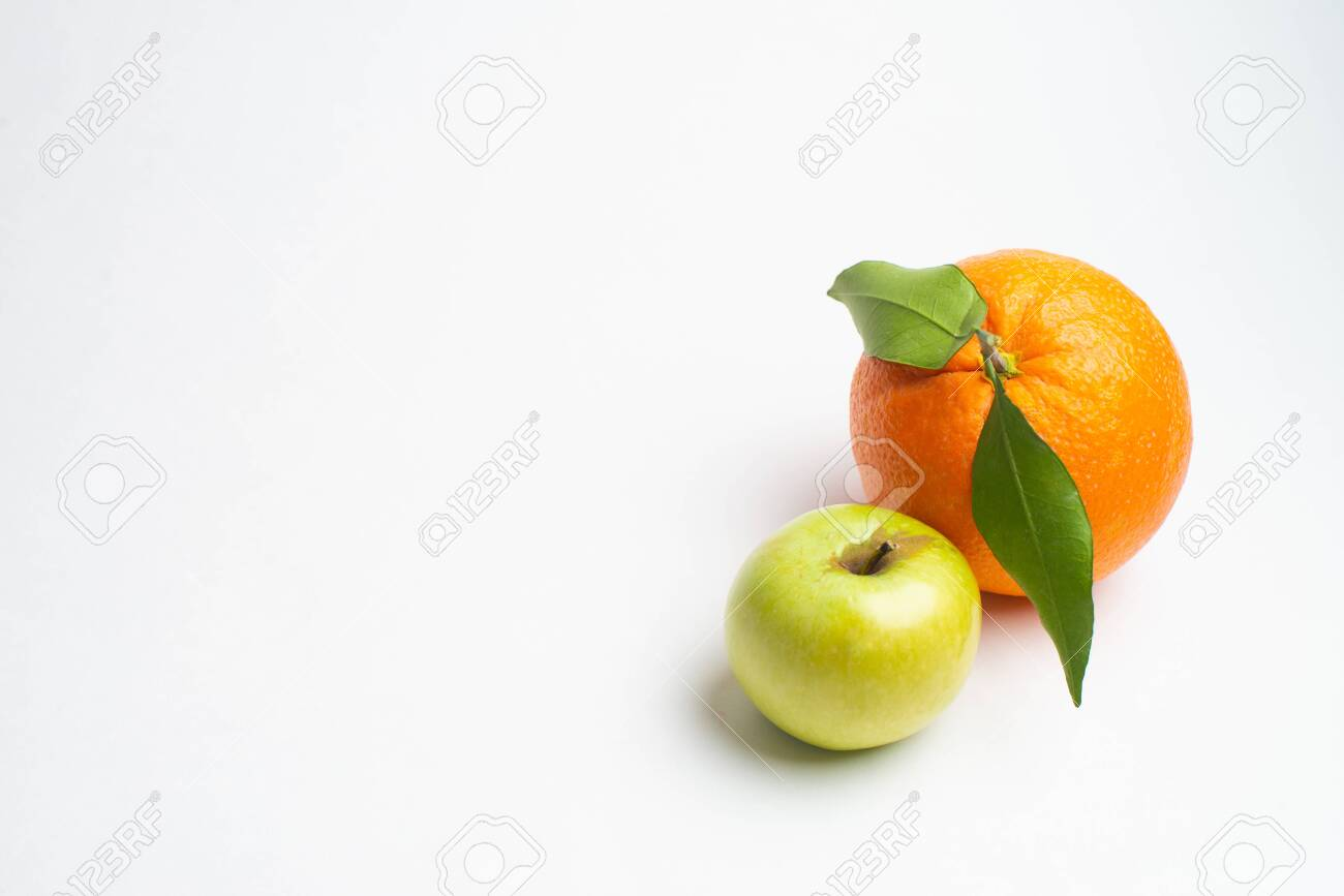 Apples and orange fresh from the garden isolated white background - 123071624