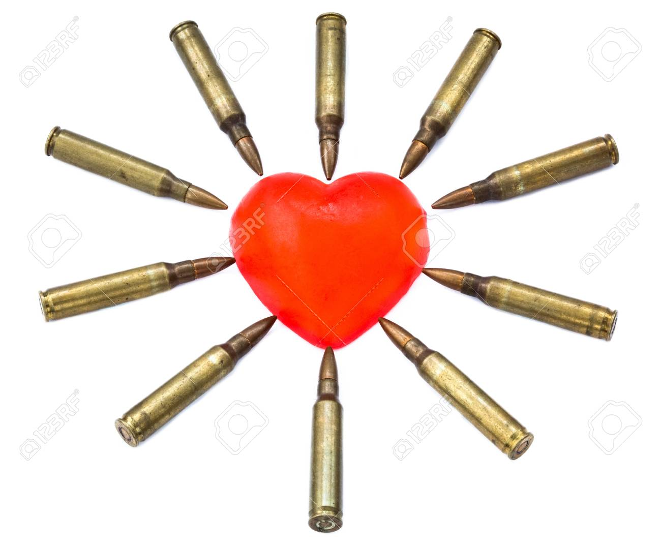 A heart shaped bar of soap is surrounded by 5.56 cartridges pointing at it. Fits the concept of 'Heart Attack'. Isolated on white background Stock Photo - 18920582