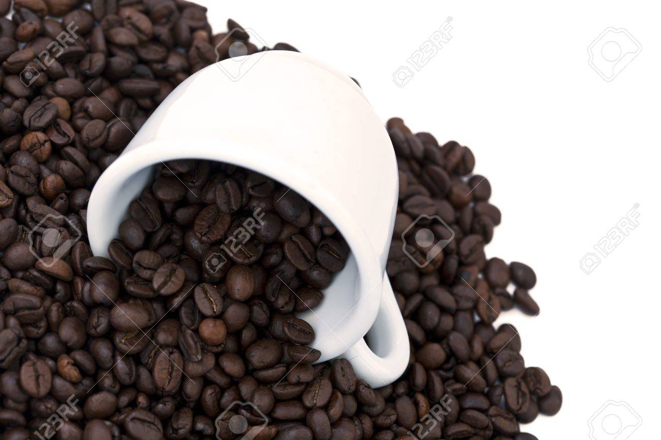 A ceramic coffee cup turned on its side with coffee beans spilling out of it. Isolated on white background. Stock Photo - 18929050