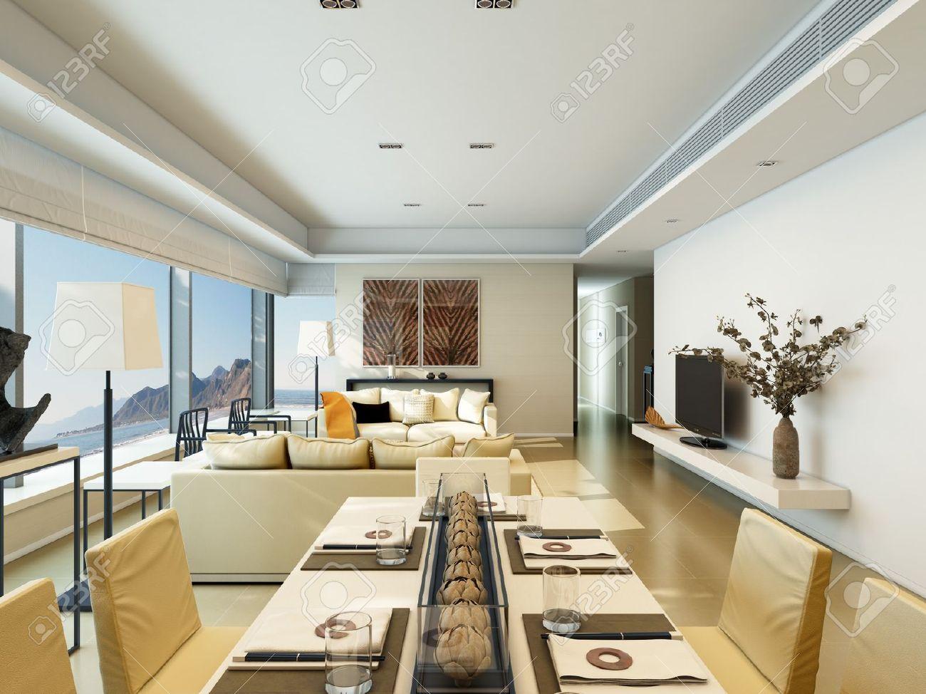Interieur van een modern huis met een woonkamer en eetkamer aan de ...